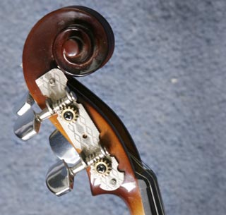 Violin scroll with guitar machine heads attached